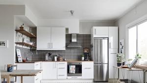 Как расположить холодильник в интерьере
