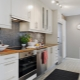 Сочетание серых стен с цветом кухонного гарнитура