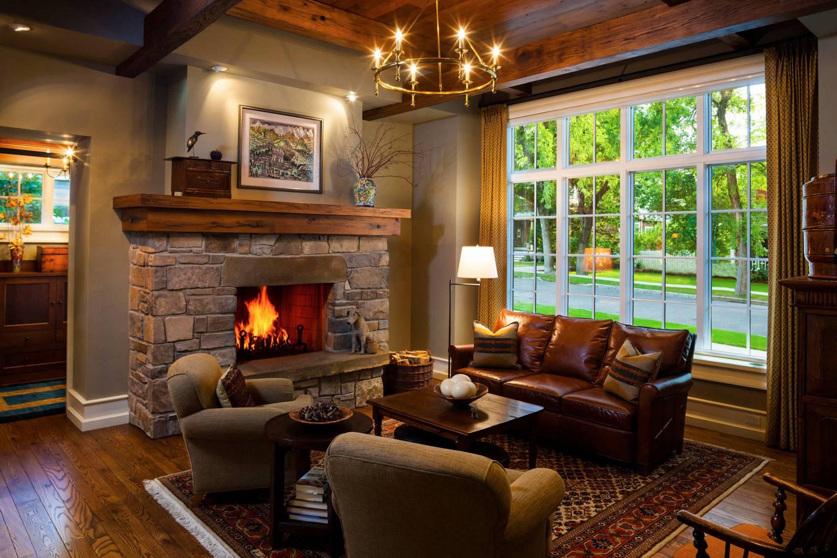 Интерьеры кухни-гостиной с камином в доме фото