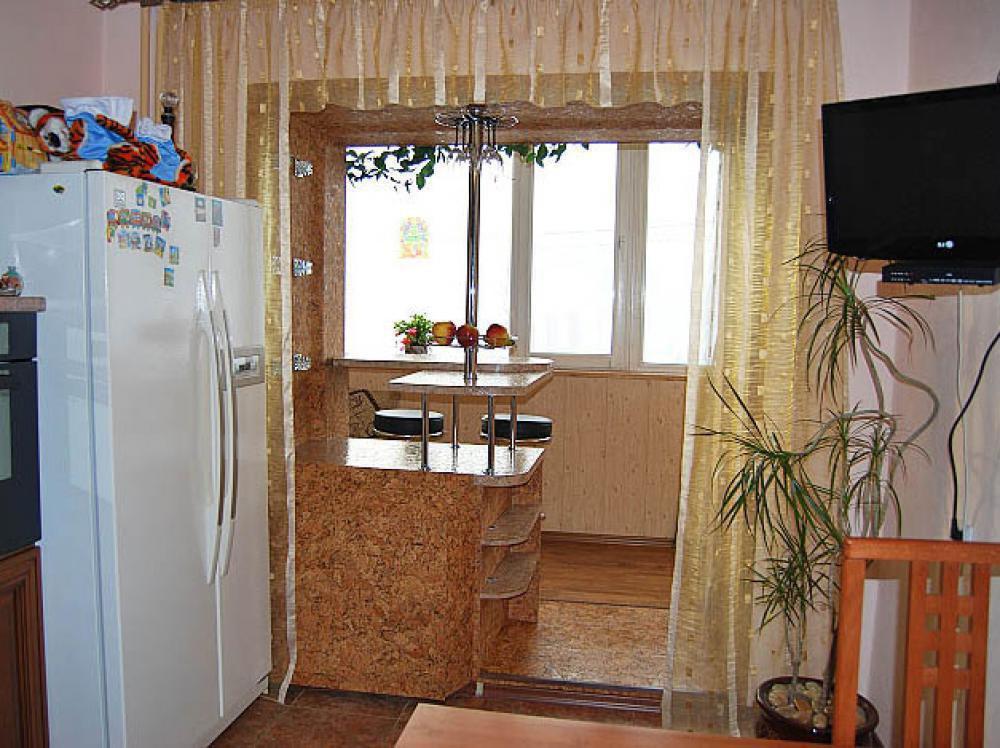 Балкон, присоединенный к кухне. как вам идеЯ?.