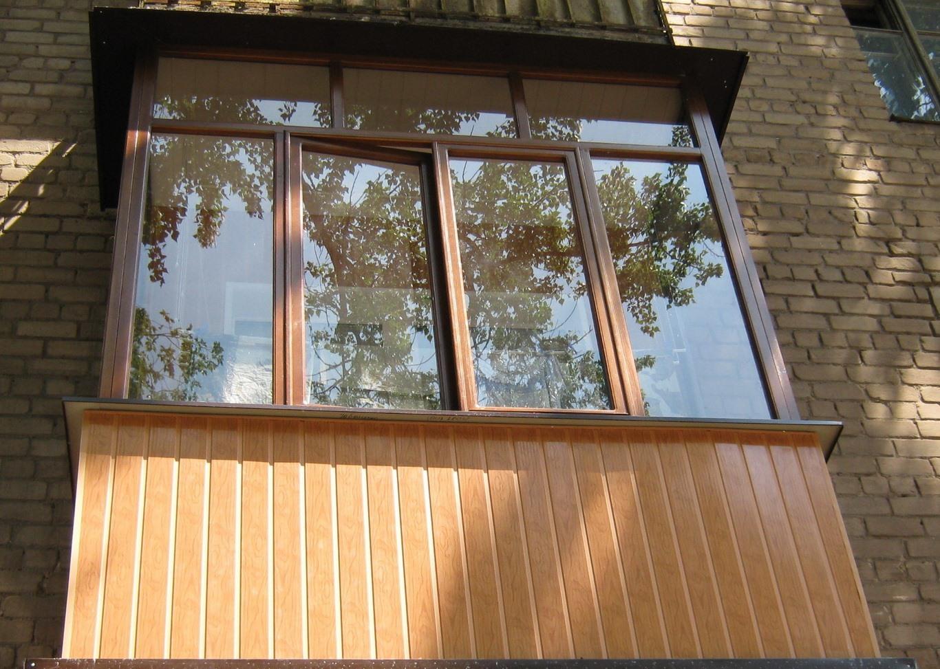 Разновидности внешний отделки балконов с фото.