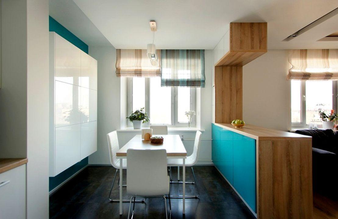 Минималистический дизайн гостиной объединенной с кухней.