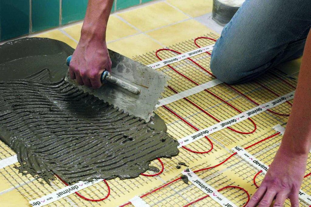 Чем залить водяной теплый пол под плитку своими руками 82